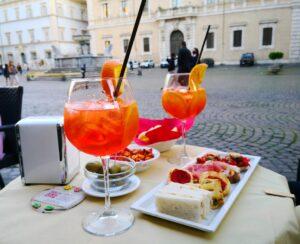 TRASTEVERE SI RIACCENDE ALL'ORA DELL'APERITIVO: NEL CUORE VERACE DI ROMA TRA SPRITZ E COPRIFUOCO